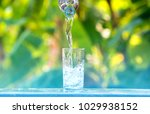drink water pouring in to glass ... | Shutterstock . vector #1029938152