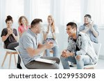 psychologist and his patients... | Shutterstock . vector #1029953098