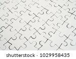 close up of a white jigsaw...   Shutterstock . vector #1029958435