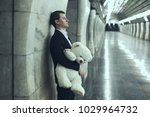 man is sad with a teddy bear... | Shutterstock . vector #1029964732