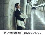 man is sad with a teddy bear... | Shutterstock . vector #1029964732