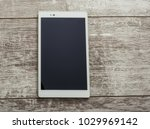 tablet pc on a wood table   Shutterstock . vector #1029969142
