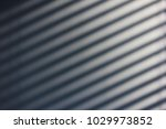 blinds making shadows on the... | Shutterstock . vector #1029973852