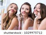 beautiful happy girlfriends in... | Shutterstock . vector #1029975712