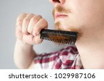 bearded man having trouble with ... | Shutterstock . vector #1029987106
