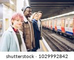tourists  commuters waiting on... | Shutterstock . vector #1029992842
