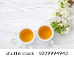 two cups of  tea and  branch...   Shutterstock . vector #1029994942