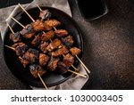 grilled beef liver on skewers ... | Shutterstock . vector #1030003405