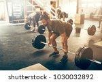 fit young man in sportswear...   Shutterstock . vector #1030032892