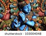 wooden statue of lord krishna | Shutterstock . vector #103004048