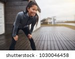 Smiling young asian woman in...