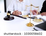 legal counsel presents to the... | Shutterstock . vector #1030058602