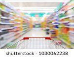 shopping cart with supermarket... | Shutterstock . vector #1030062238