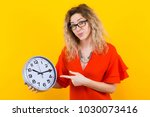 woman in dress with clocks | Shutterstock . vector #1030073416