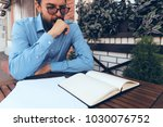 man looking at a notebook ... | Shutterstock . vector #1030076752