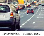 blurry cars and traffic in the... | Shutterstock . vector #1030081552