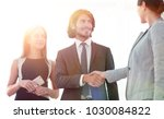 businesspeople  shaking hands... | Shutterstock . vector #1030084822