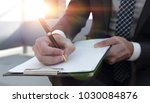businessman signs a contract.... | Shutterstock . vector #1030084876