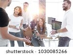 team of young employees... | Shutterstock . vector #1030085266