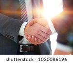 businessman giving his hand for ... | Shutterstock . vector #1030086196