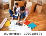 young couple moving into a new... | Shutterstock . vector #1030105978