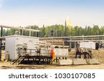 small oil refinery next to... | Shutterstock . vector #1030107085