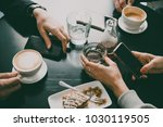 friends sitting in cafe and... | Shutterstock . vector #1030119505