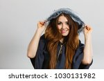 happy woman wearing dark poncho ... | Shutterstock . vector #1030131982