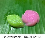 classy sweets on a banana leaf | Shutterstock . vector #1030142188