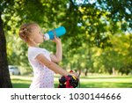 little pretty girl with bicycle ... | Shutterstock . vector #1030144666