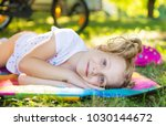 excited face of pretty small... | Shutterstock . vector #1030144672