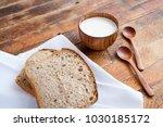 bread slices on white kitchen... | Shutterstock . vector #1030185172