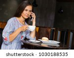 woman talking with friends by... | Shutterstock . vector #1030188535