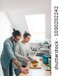 young couple making breakfast... | Shutterstock . vector #1030202242