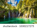 big waterfalls in plitvice... | Shutterstock . vector #1030217275