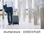 business man dragging suitcase... | Shutterstock . vector #1030219165