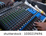 hand operating sound mixer... | Shutterstock . vector #1030219696