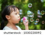 asian girl play a bubble in...   Shutterstock . vector #1030220092