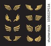 gold glitter wings vector set.... | Shutterstock .eps vector #1030229116