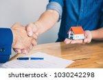 real estate agent shaking hands ... | Shutterstock . vector #1030242298