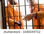 multicultural prisoners... | Shutterstock . vector #1030245712