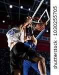 two basketball players in...   Shutterstock . vector #1030255705