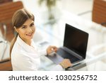 portrait of young woman working ... | Shutterstock . vector #1030256752