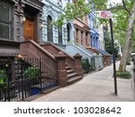 brownstone homes tree lined... | Shutterstock . vector #103028642