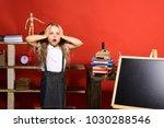 schoolgirl with frightened face ... | Shutterstock . vector #1030288546