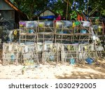 Fish Cages Traps Stacked Near...