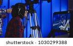 woman wearing a headset sitting ... | Shutterstock . vector #1030299388