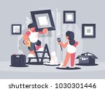 guy hangs picture on wall. wife ... | Shutterstock .eps vector #1030301446