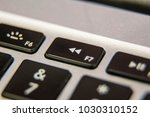rewind f7 keyboard key button... | Shutterstock . vector #1030310152