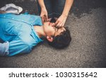 emergency first aid on a man... | Shutterstock . vector #1030315642